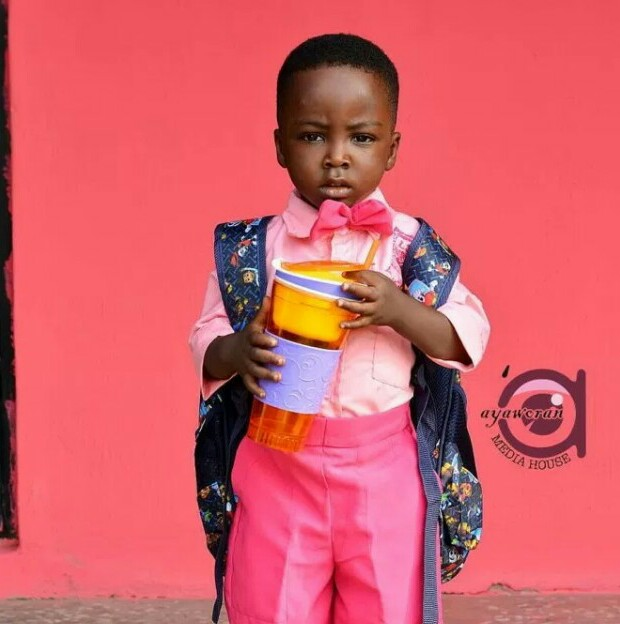 Boy Who Went Viral After He Photobombed a Wedding Picture, Begins School. (Photos)